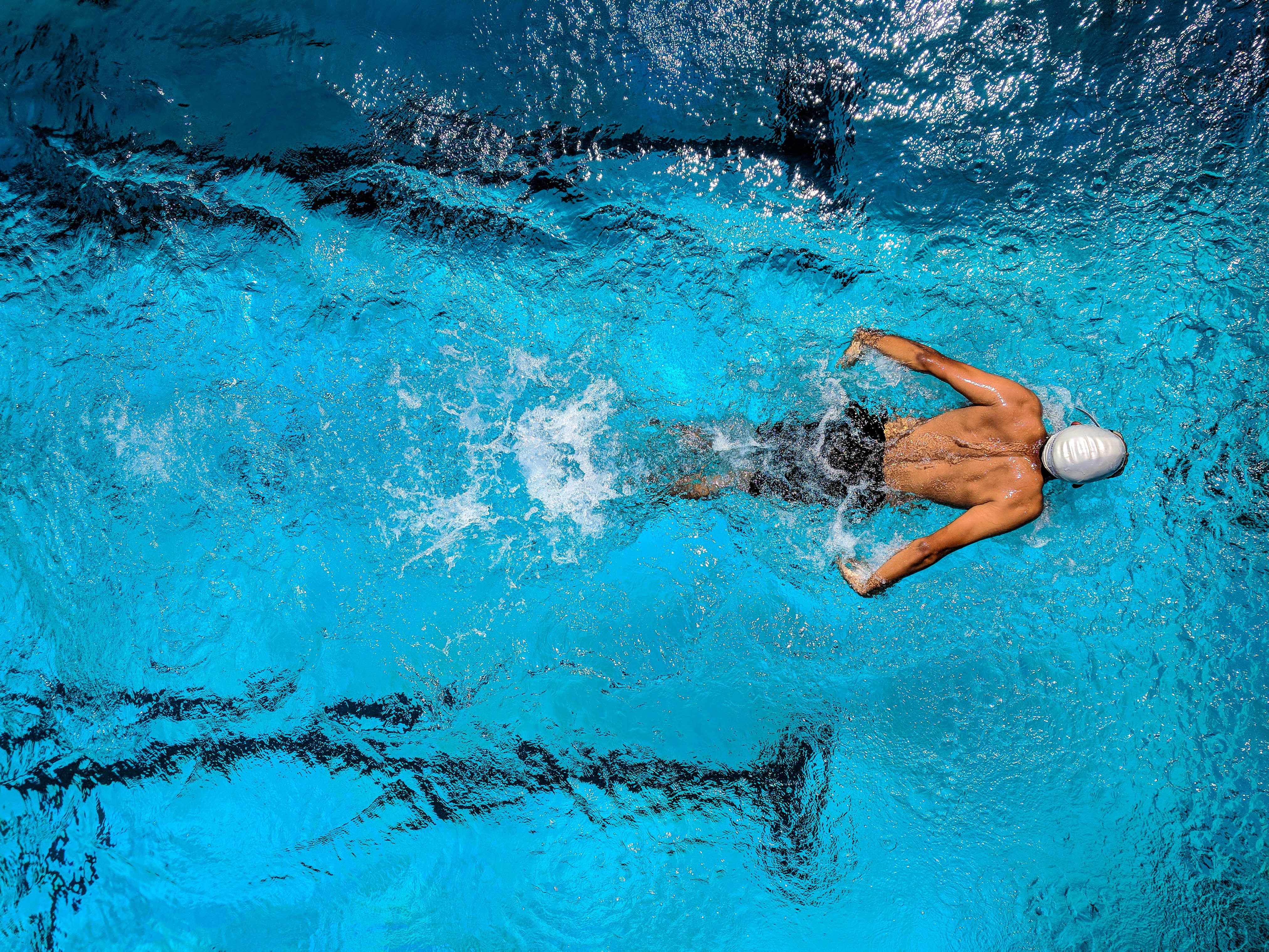 a man swimming laps in a pool